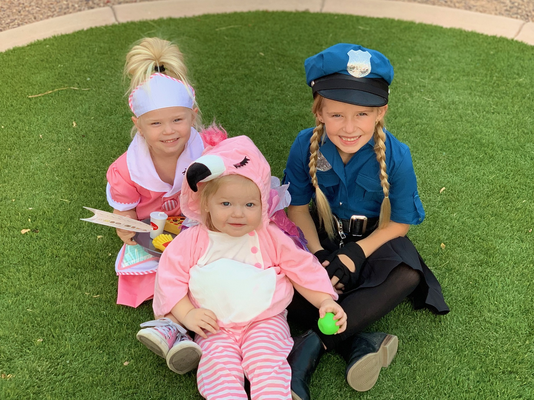 Halloween Costumes 2019! Our trip down Halloween costume memory lane and good costume ideas for kids and babies! (Cop, Waitress + Pink Flamingo)